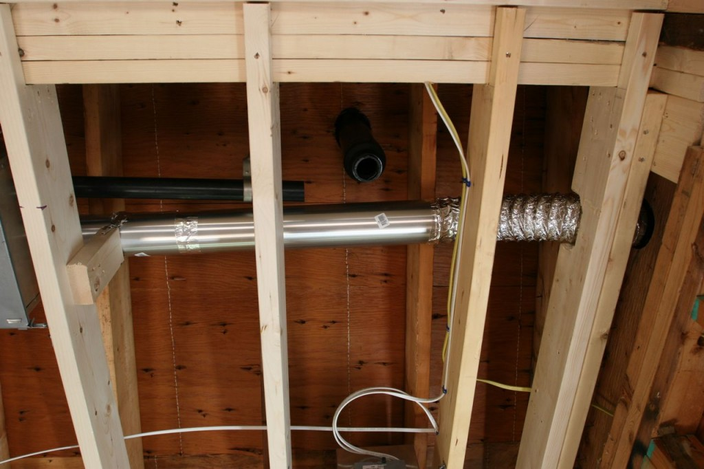 Ducting, plumbing above new portion of kitchen (formerly bathroom).