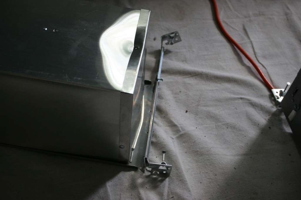 """We did receive our recessed lights, albeit mangled by the shipping process. (Simply marking something """"fragile"""" doesn't protect it from harm, Juno!) This is one of the two that are smashed beyond use."""