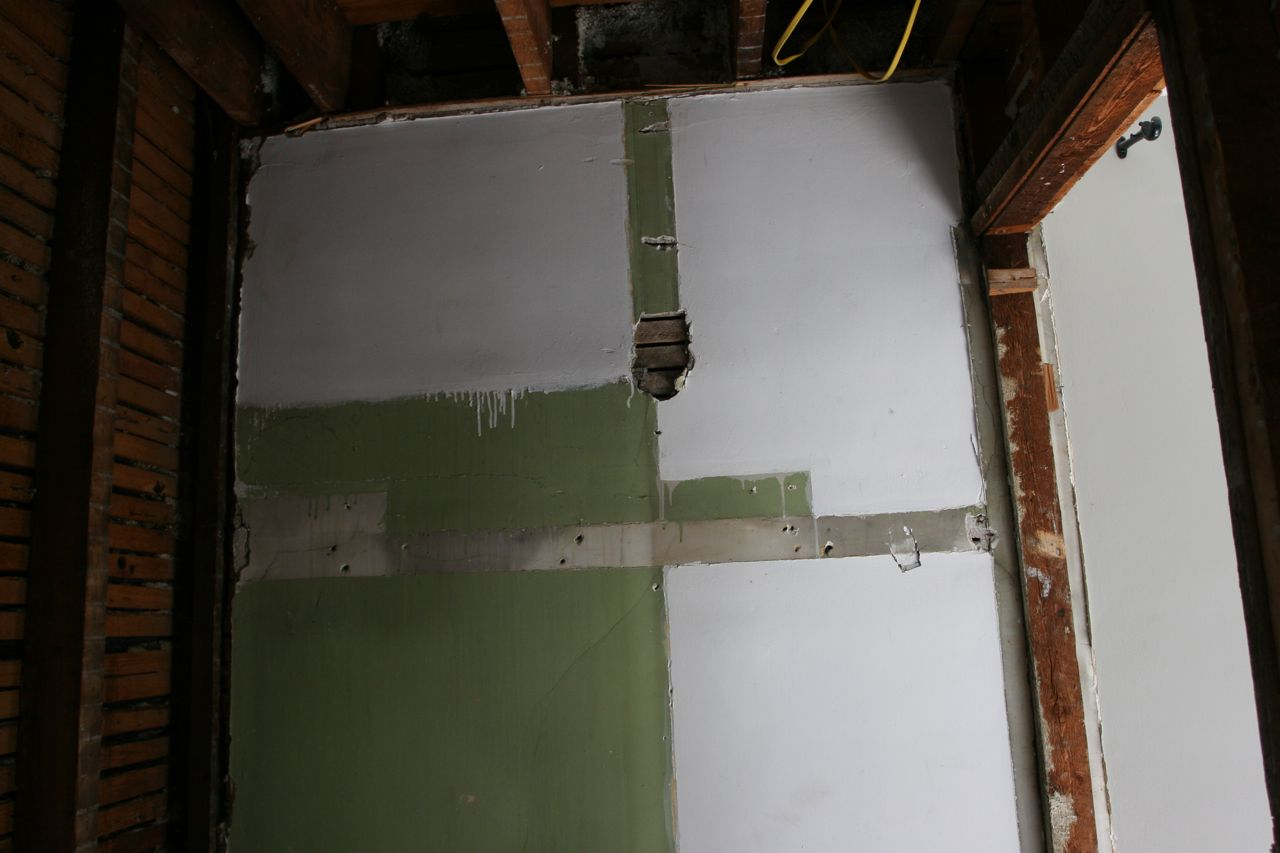 Evidence that the master shower was once merely a closet for the maid's room. The green area became a stall shower sometime along the way.