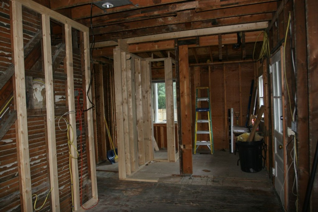 Walls are going up! That old support beam will come down once the rest of the framing gets in place.