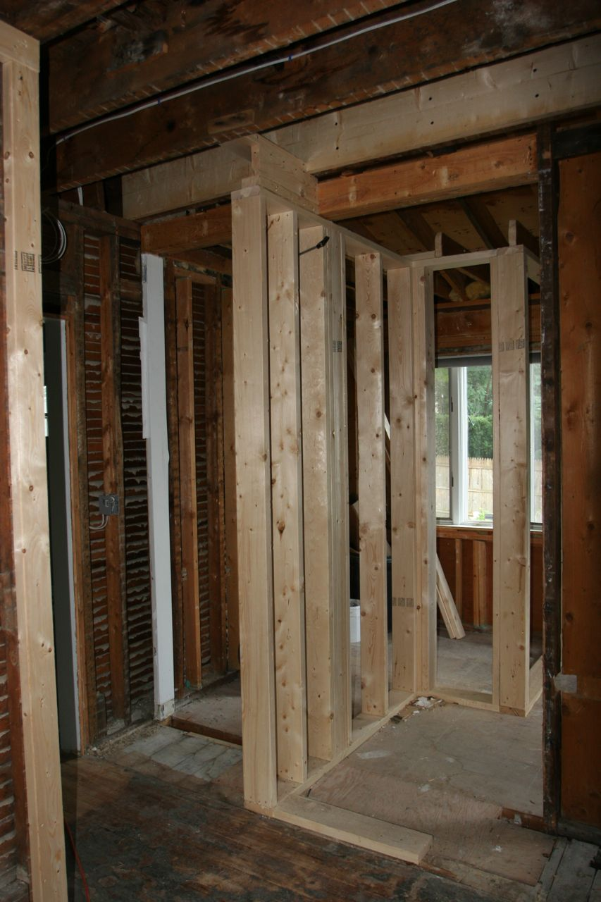 This new wall structure will separate the powder room from the kitchen and dining room.  That means no more bathroom IN the kitchen!