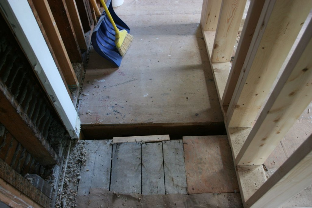 Somewhere along here will be a threshold and a doorway to our downstairs powder room.