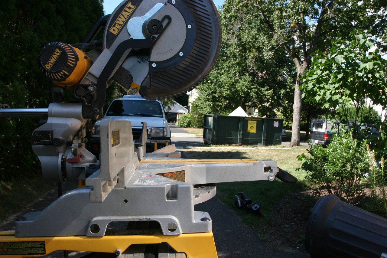 The chop saw in our make-shift workshop: the driveway!