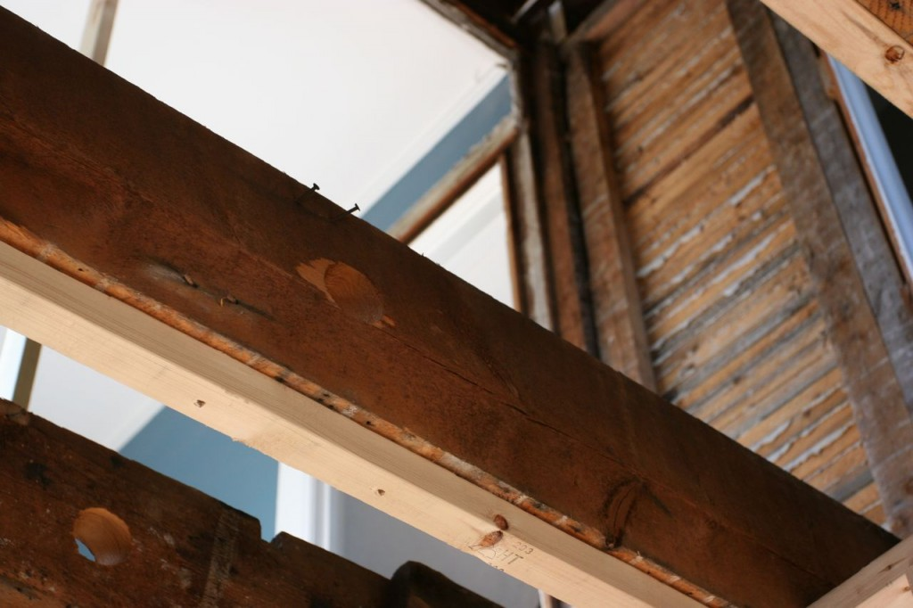 Some of the strapping (to make the ceiling level-ish and a tad lower) on the joists beneath the naked future master bath.