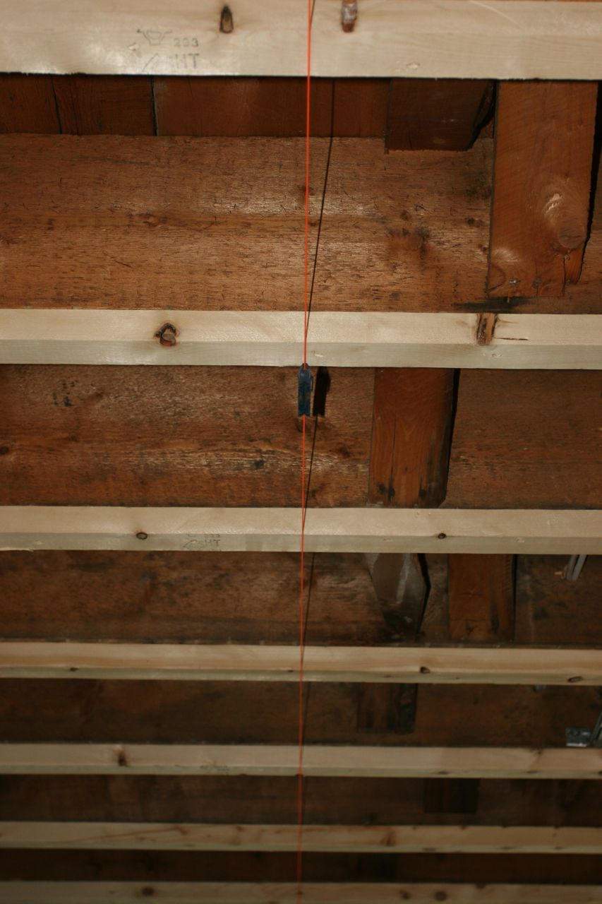 The little orange string is telling the builders just how un-level our ceiling is. And the kitchen in general.