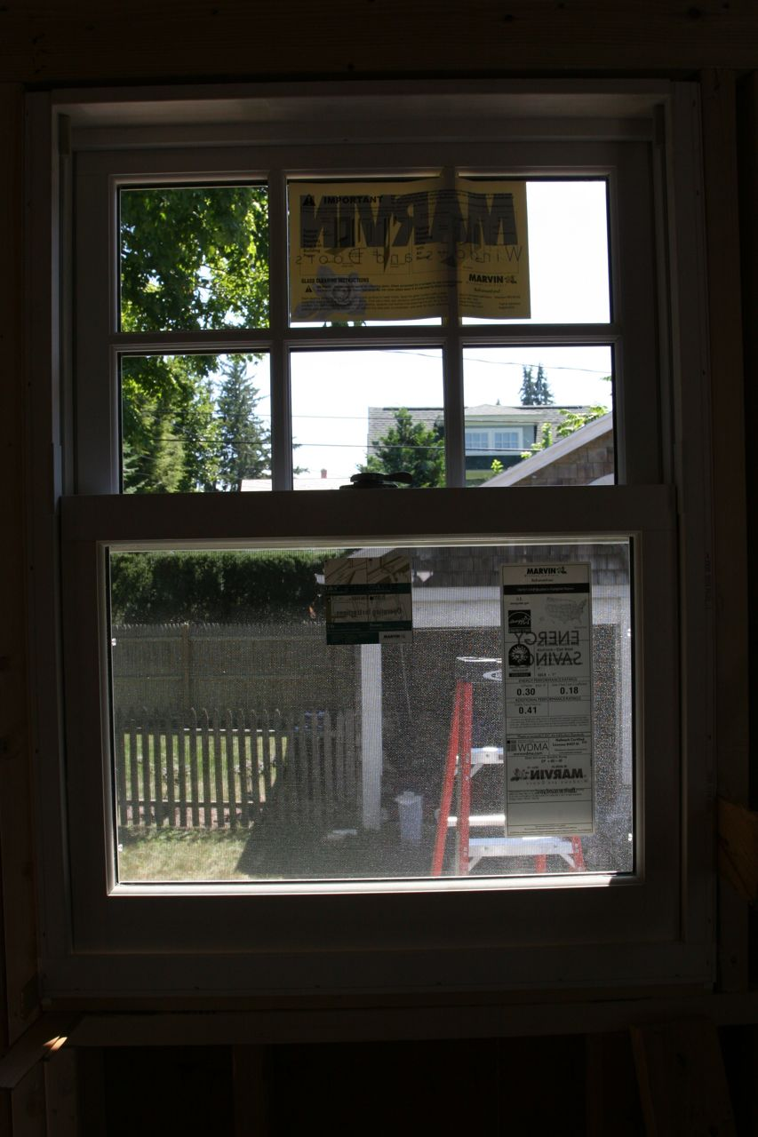 Cue angelic, heavenly choir singing. We have a new kitchen window!