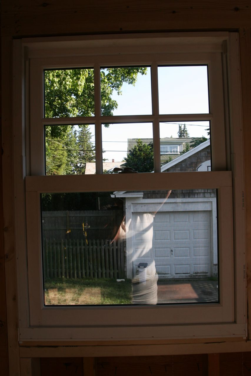 View from the brand new window opening. In the spring, the scent from the neighbor's lilac bushes should waft right into the kitchen through this very window. Ahhh.