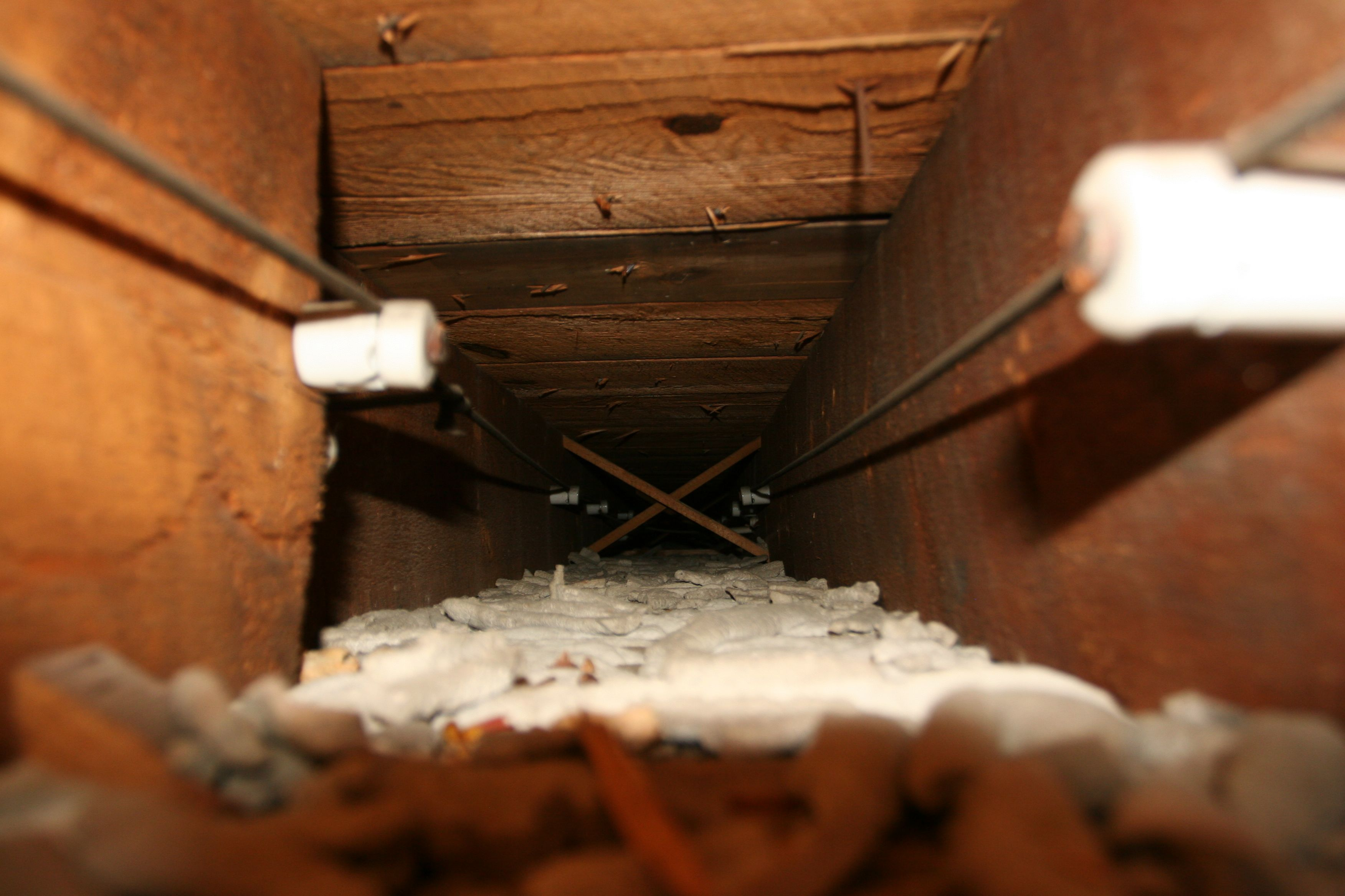 "Knob and tube, a ""trunk line"" running between the joists from the kitchen to the dining room."