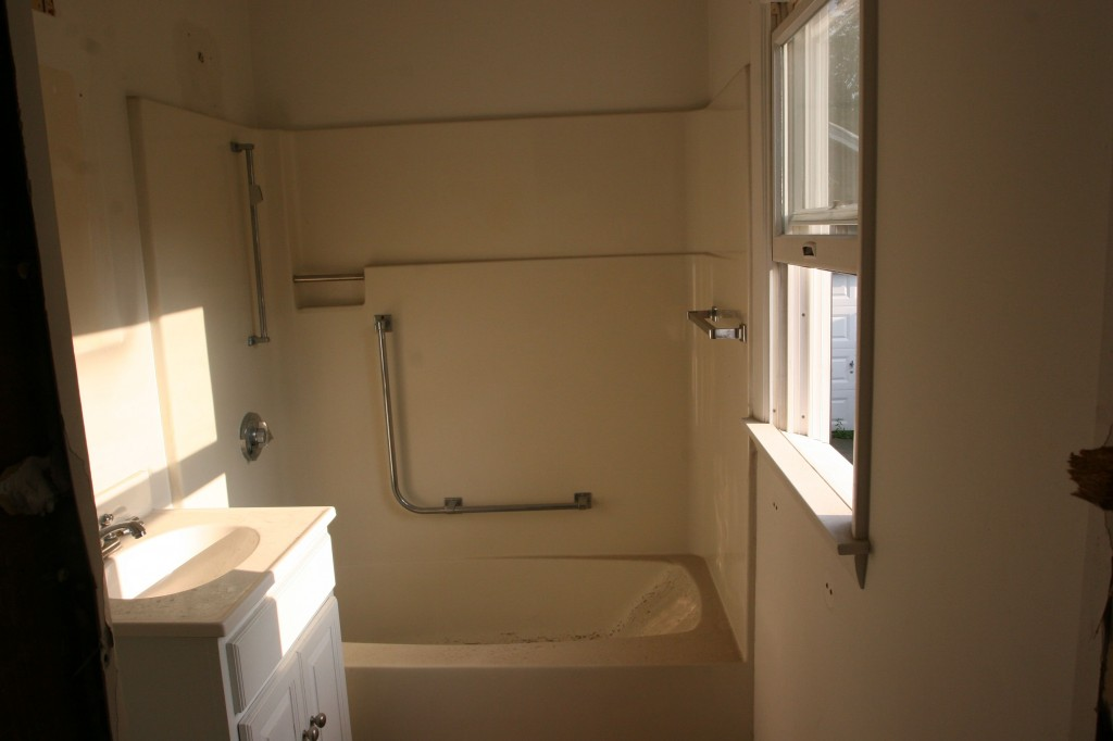 Realized I hadn't included photos of the full bath on the main level. Kind of a between, rather than a before, but you get the idea.