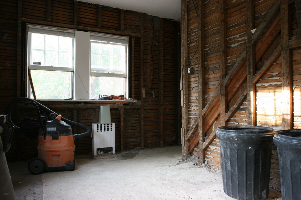 Front of kitchen, future home of a breakfast bar, and pantry at foot of maid's staircase.