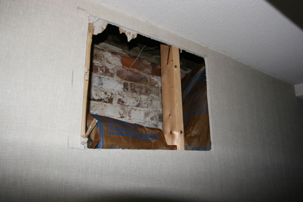 An access hole for the basement rewiring. We have wallpaper we can patch those spots with when the time comes.