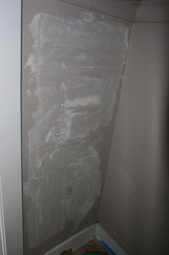 First skim coat to remedy hammer-stressed plaster in master closet.