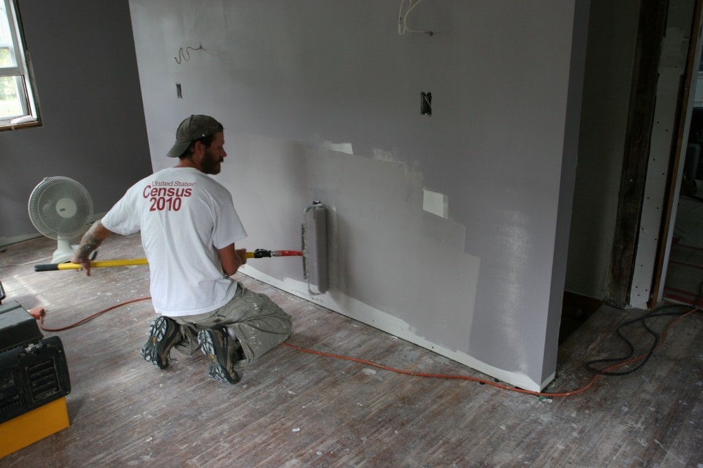 Eric sweeping away the last of the naked sheetrock.
