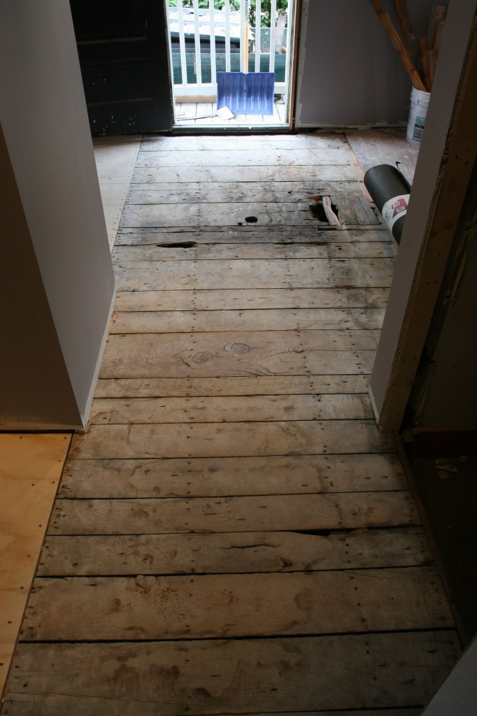 Eric prepared the floor by removing some of the old wood (patched from eons ago) and re-nailing down the subfloor.