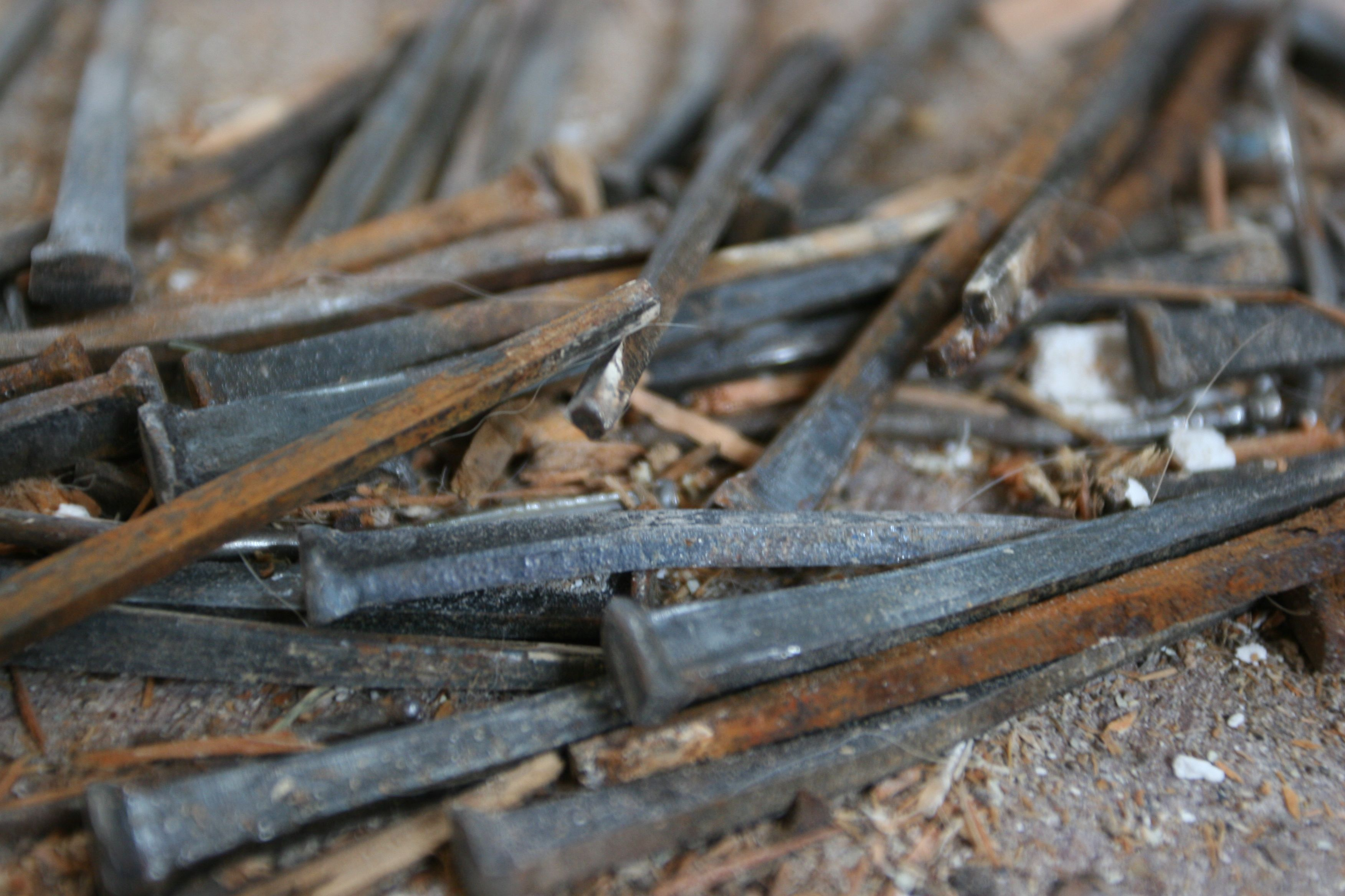Piles of old hand-forged square nails were pulled out of the antique boards so we can re-use the wood upstairs.