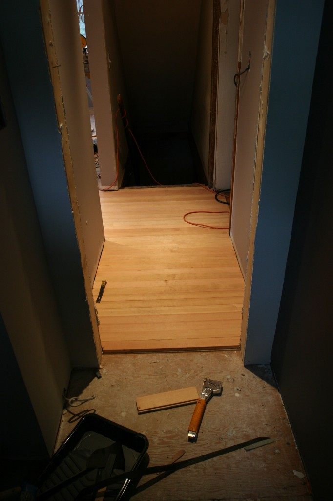 View from the powder room to the basement entrance.