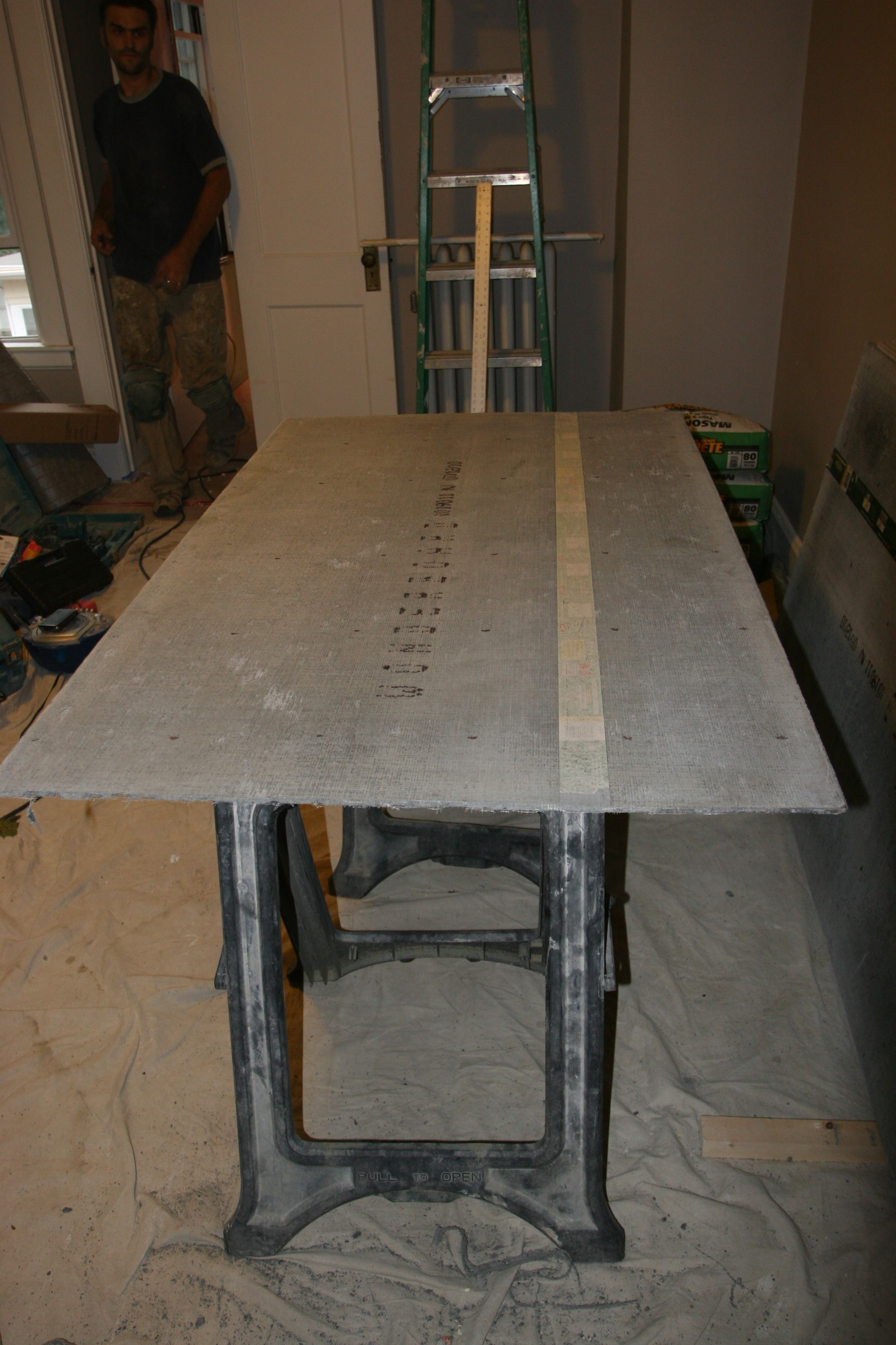 """Cutting 1/4"""" durock to size for floor underlayment."""