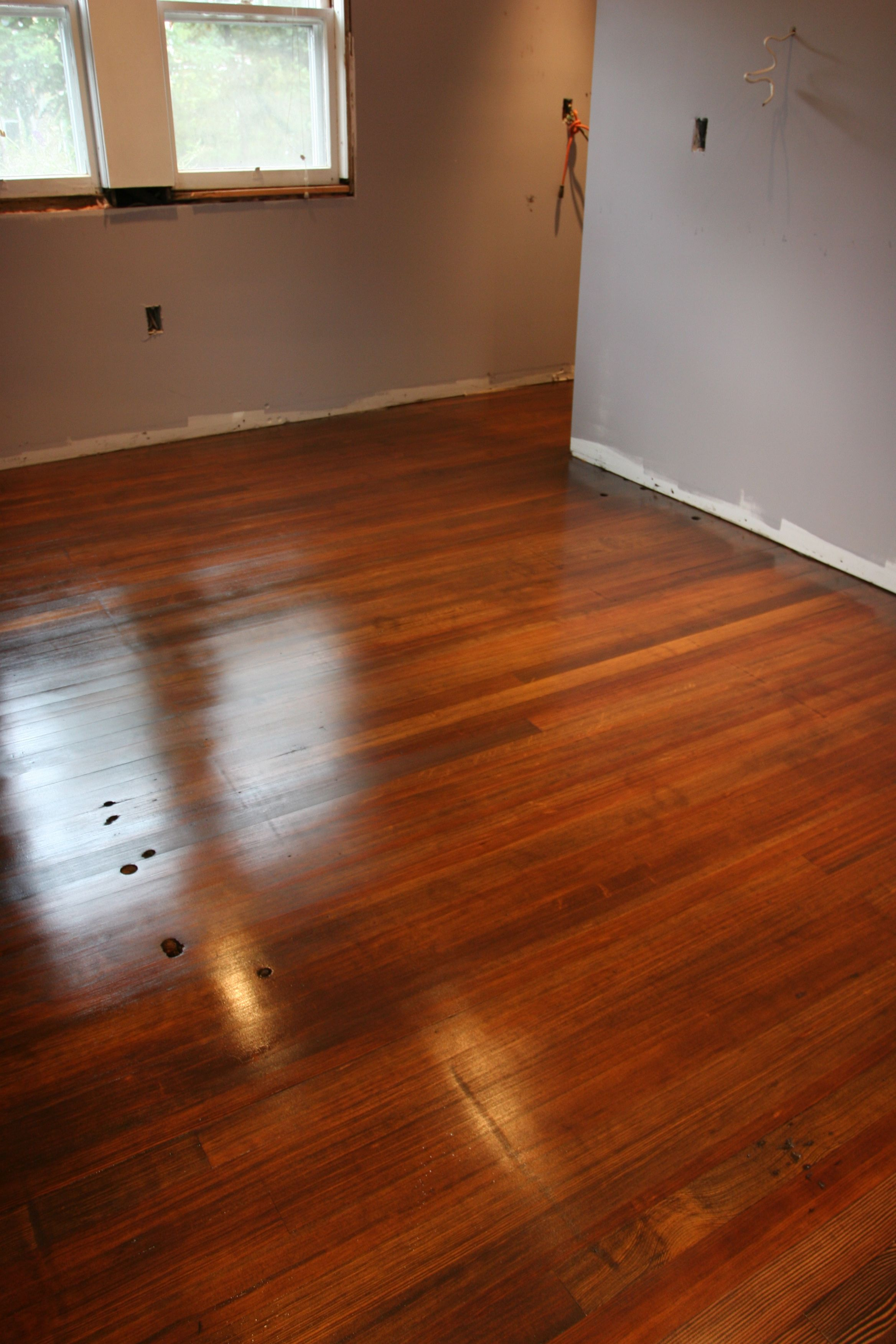 Gorgeous and glossy. The matte finish isn't as strong - it'll dull to a lovely well-worn floor over time naturally.