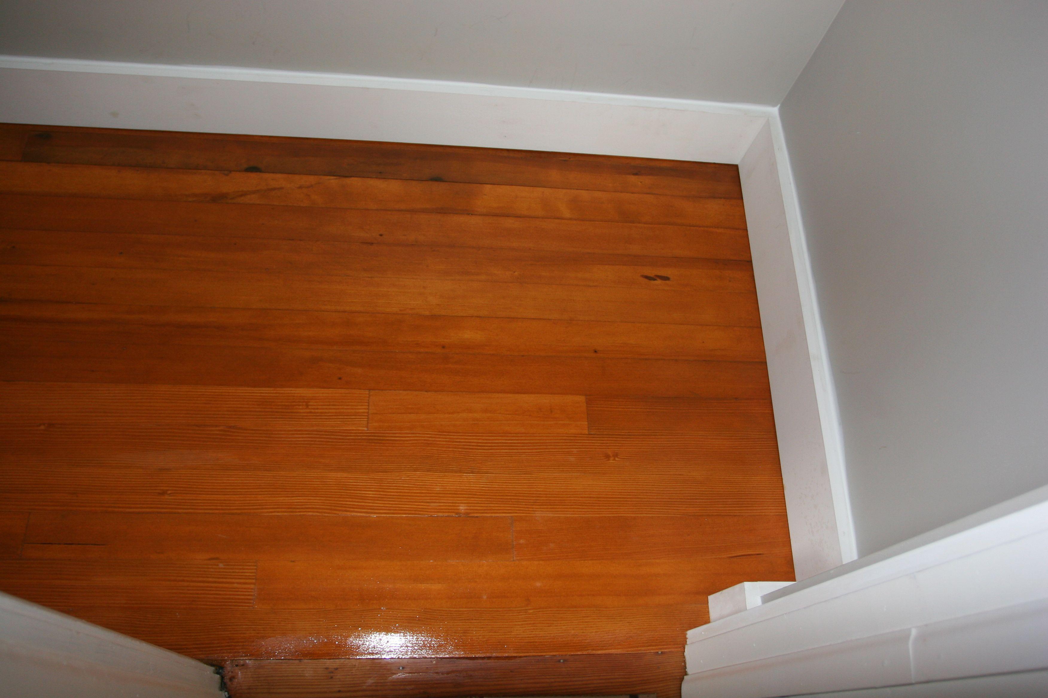 Closet floor with first sealer coat, and finish trim! Looks original! LOVE!