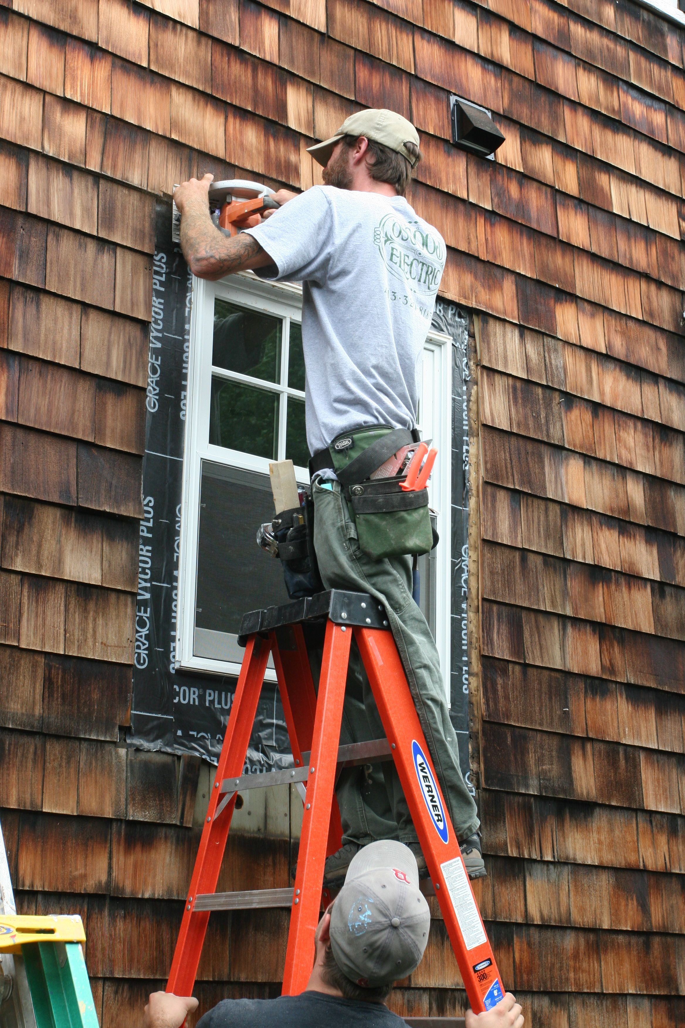 "Eric sawing off 1/2"" of shingles that didn't belong."