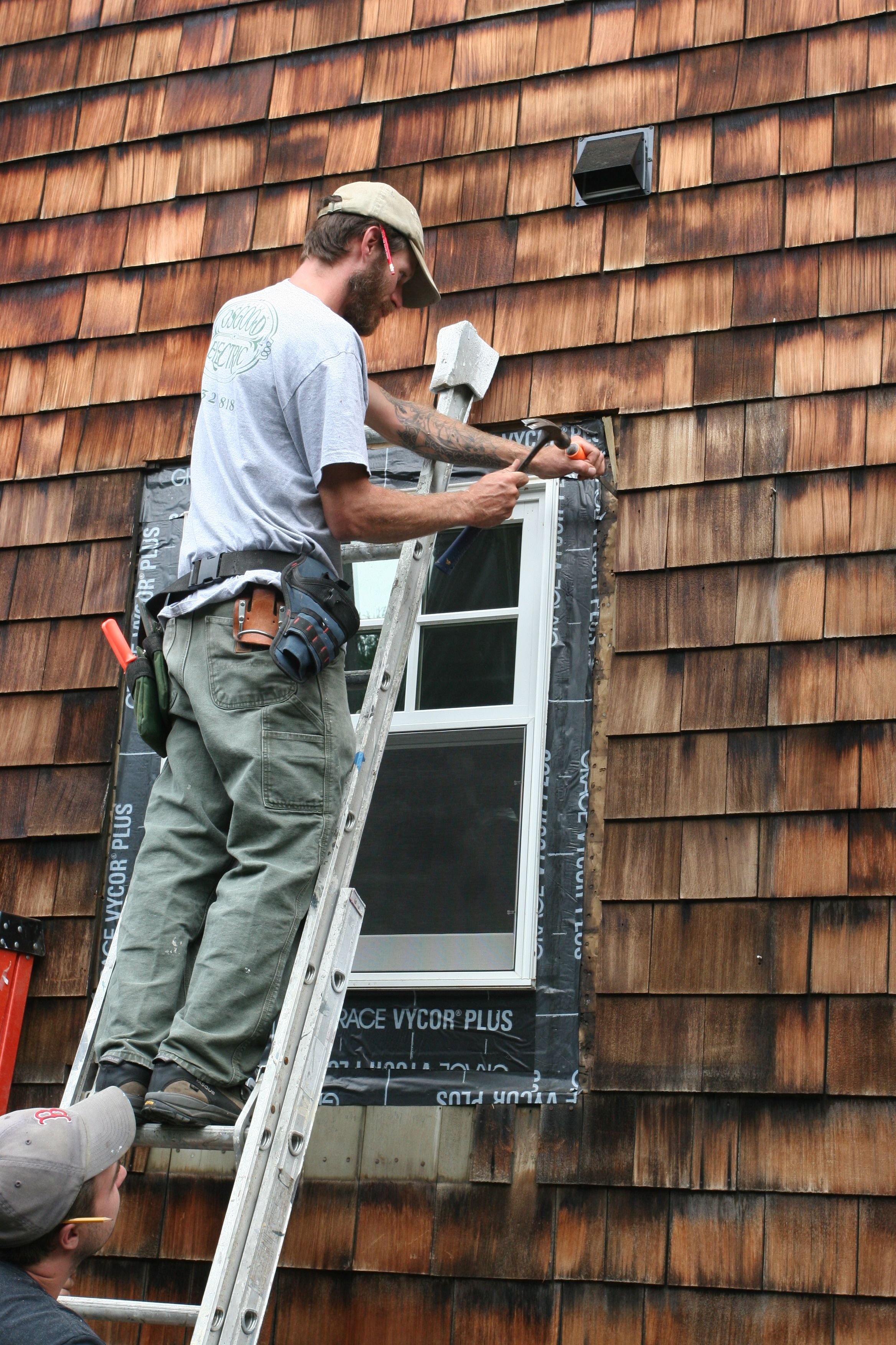 Hand work, chiseling out the brittle shingles.