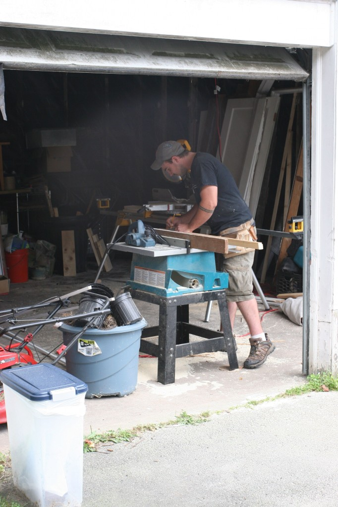 Dave rocked the stationary sawing machines, while Eric worked the ladder.