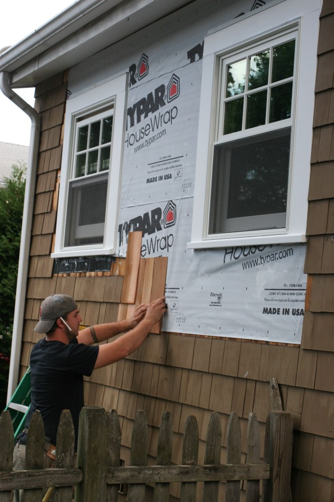 """Dave on task for rabbiting shingles to """"button up"""" the outside."""