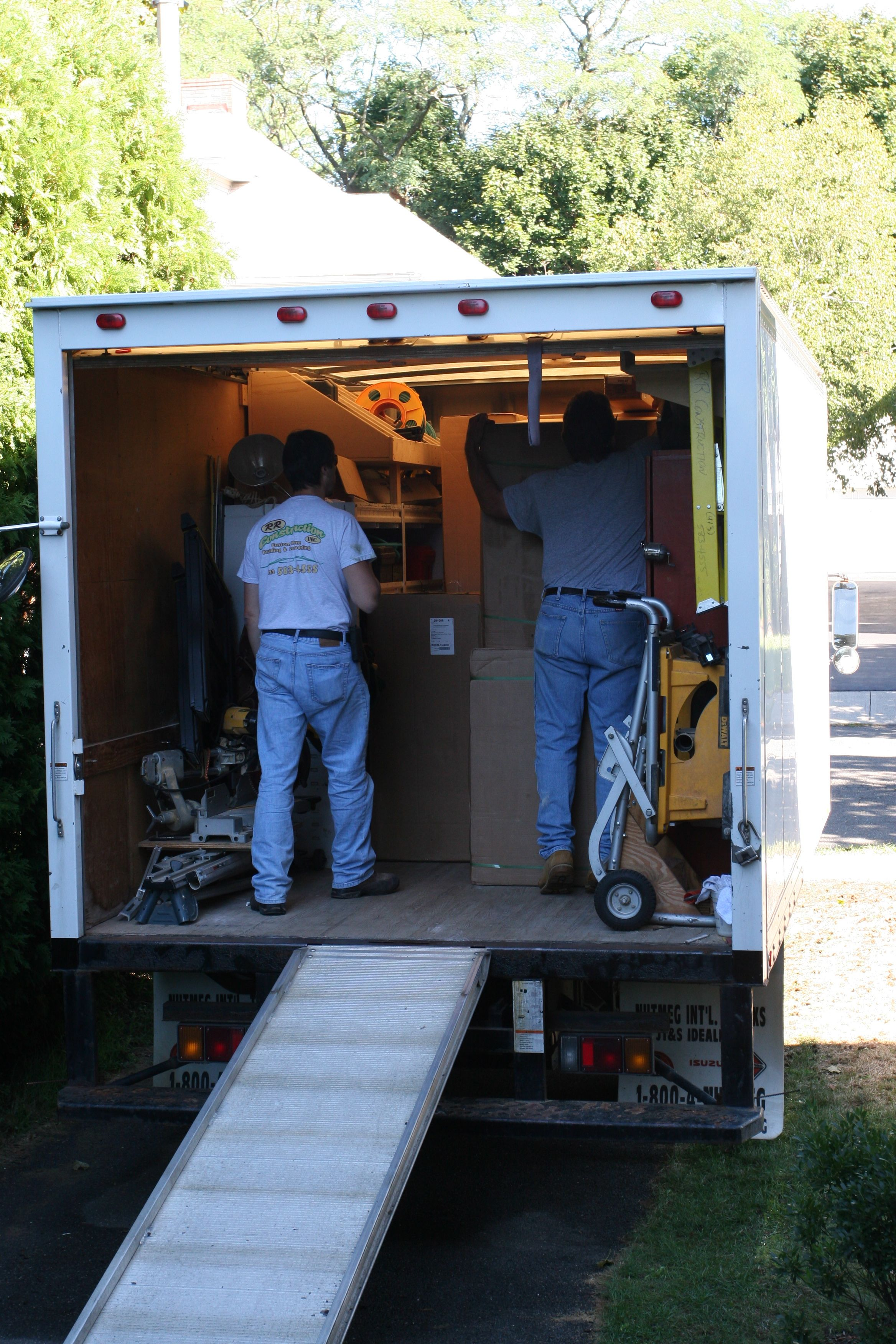George and Matt from Artistic Interiors unloading the truck.
