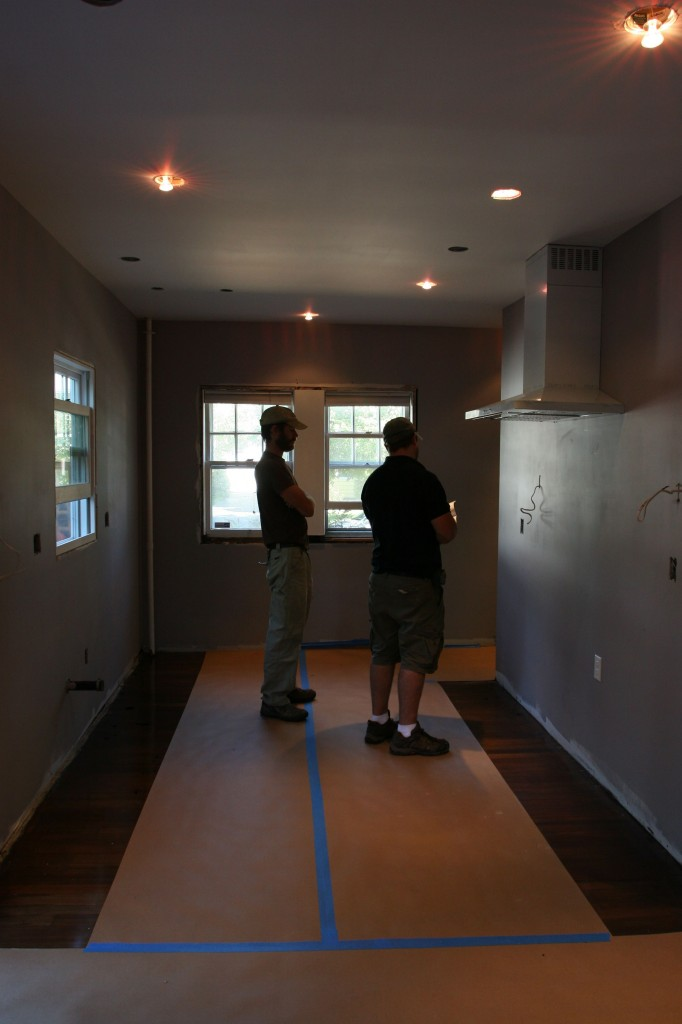 Eric and Dave attacking the layout for the cabinets.