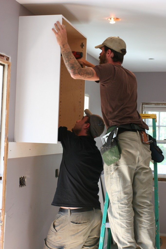 Attaching the cabinet to the blocking that they put in the walls in anticipation of cabinet needs. Smart fellas.