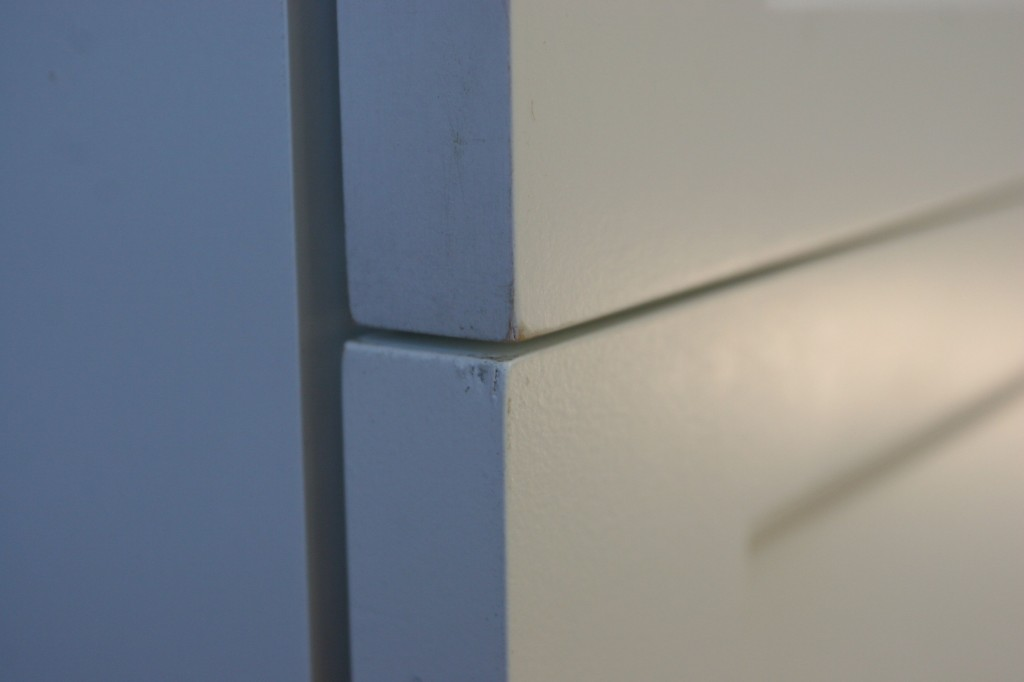 Drawer fronts - not easy to have replaced, but we might have to. The touch-up doesn't seem to do the job.