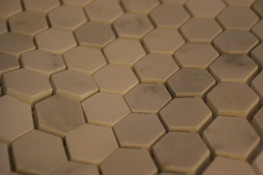 Marble hex tile for the master shower and master bathroom.
