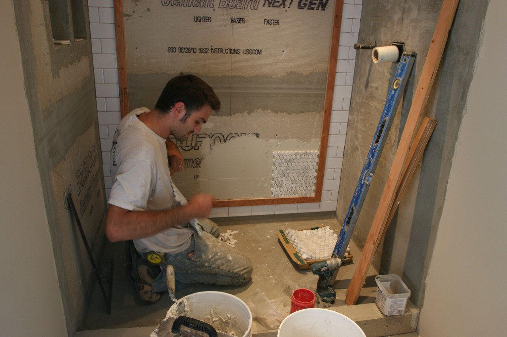 Each tile sheet is about one square foot, separated by plastic (to prevent scratching) and adhered to a mesh backing.