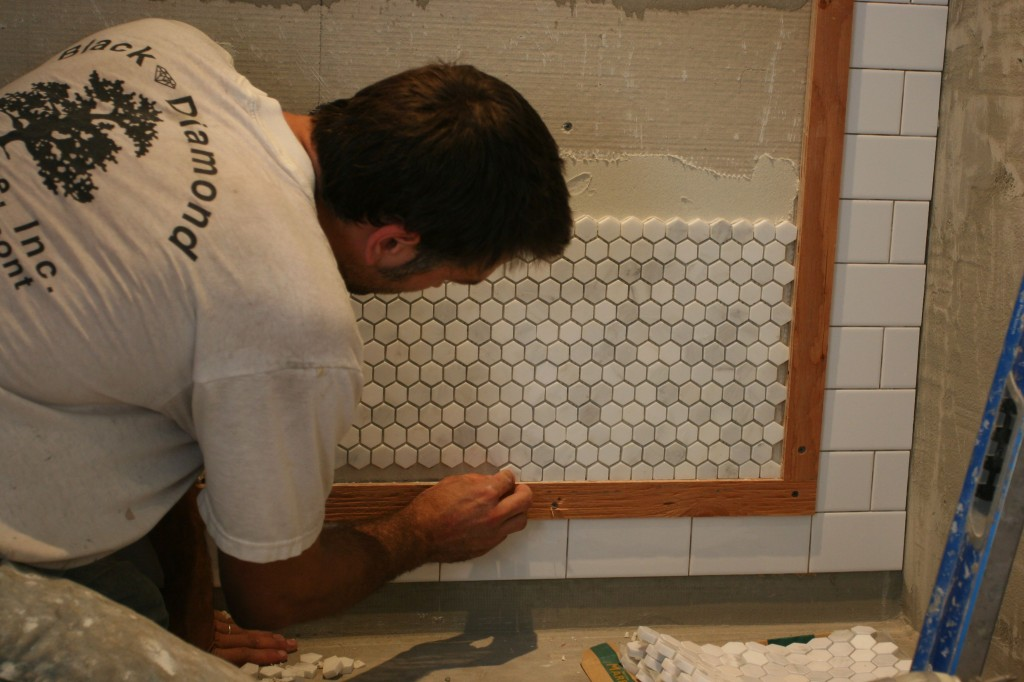 Caleb then had to insert each pre-cut tile into the edges by hand. Thankfully his eye is as skillful as his hand.