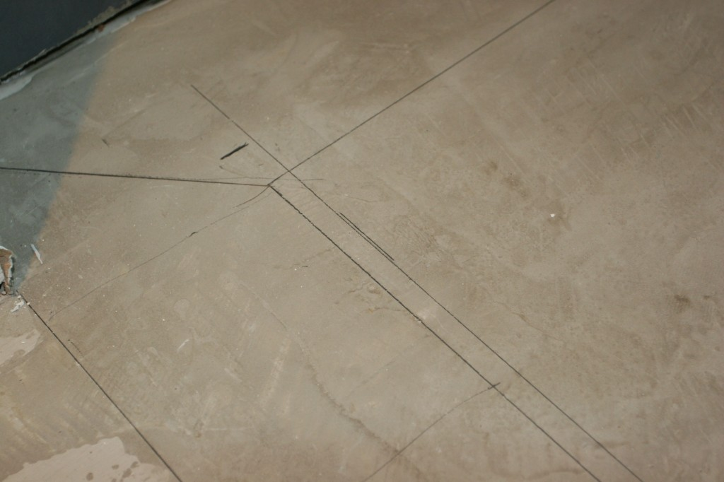 The dry layout, drawn in pencil right onto the floor.