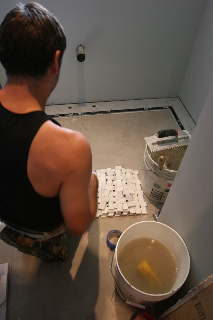 After everything was numbered, cut, and dry fit into place, Caleb began actually setting the tile.
