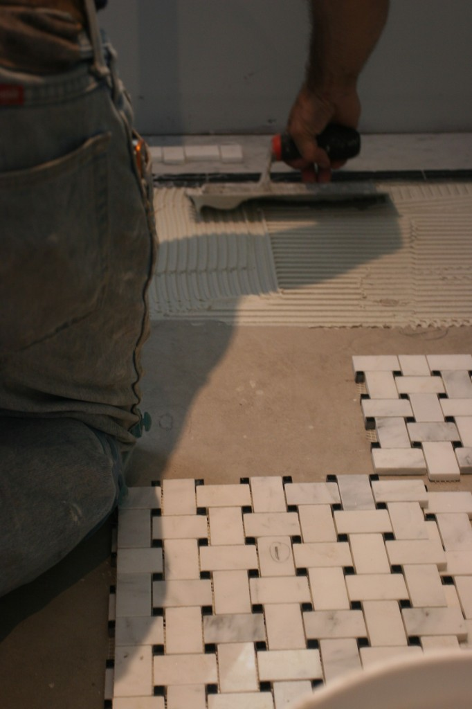 The actual thickness of the thin-set made a difference in how high the tile ended up, and how much extra material would squeeze through the cracks.