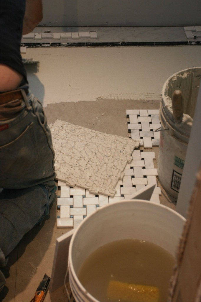 I loved the texture of the thin-set on the back of the tile sheets as Caleb adjusted the height.