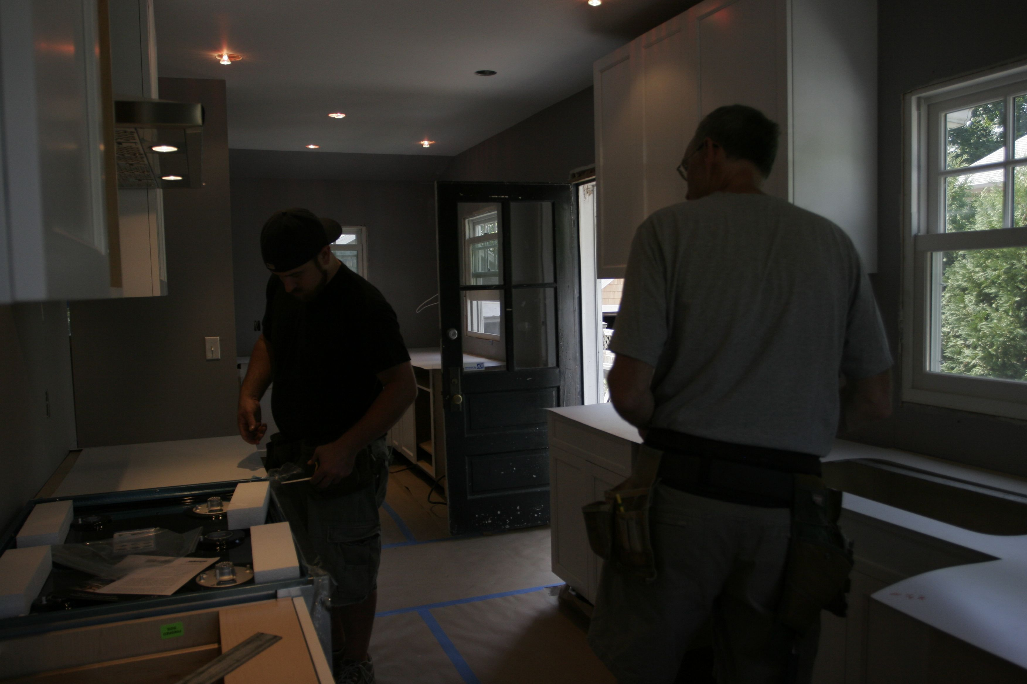Tom and Dave figuring out the best bracing solutions for the stone that'll surround the slide-in cooktop.