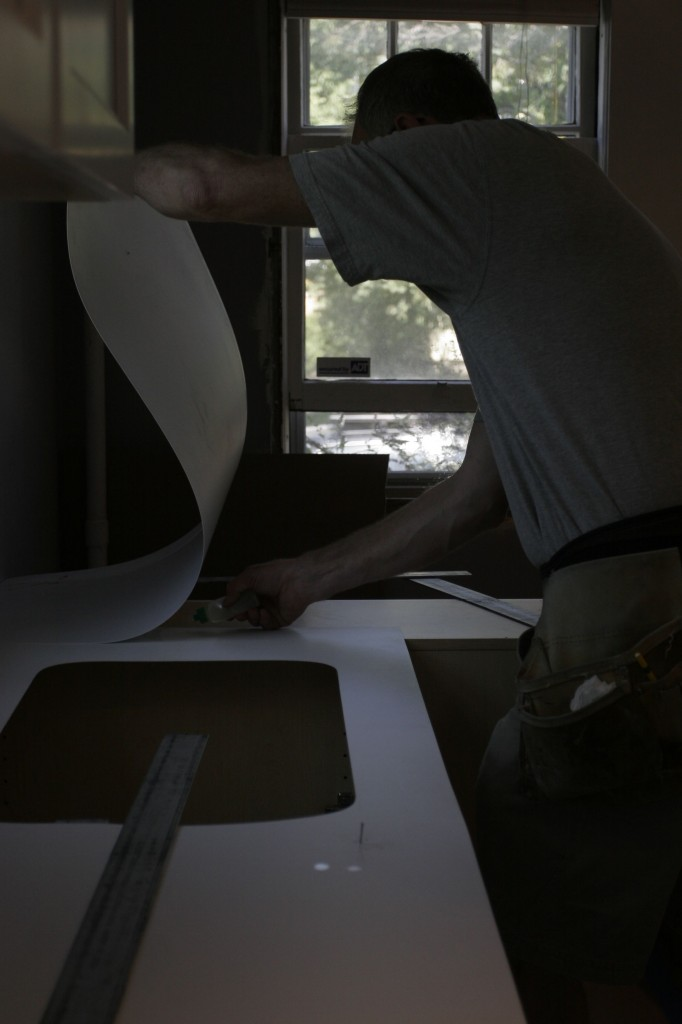 Again, an unintentionally dark photo, but still looks rather dramatic. Tom's gluing together the pieces of sheet PVC for the stone workers to match exactly.