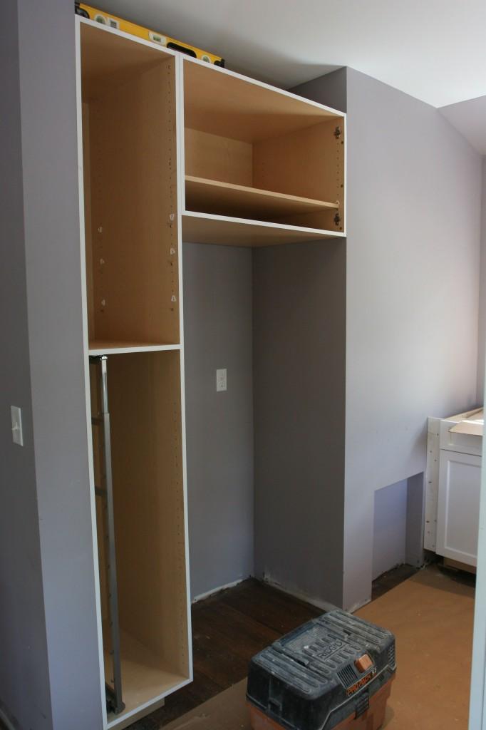 Pantry, refrigerator nook, extra storage. Pretty sweet.