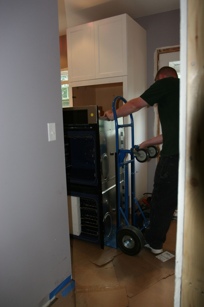 Brad setting up for wall oven install. (This was before Dave and Brad figured out that the cabinet needed some shoring up to be an effective (read: safe) place to mount a 300+ lb. appliance with moving parts.