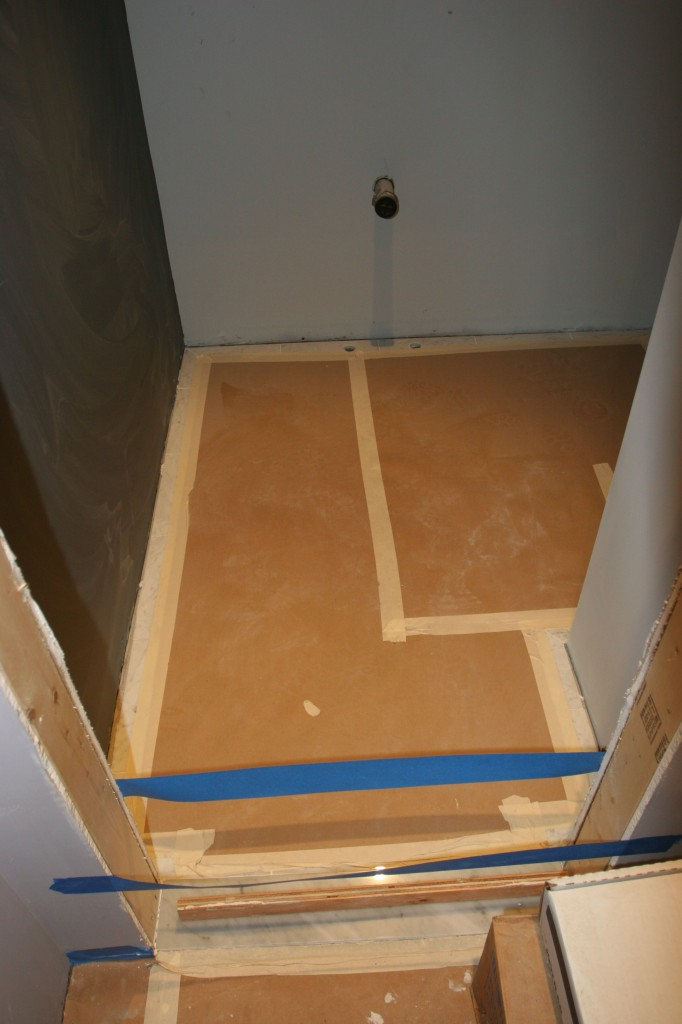The threshold is done, the floors are sealed and protected. Next up: plumbing and trim!