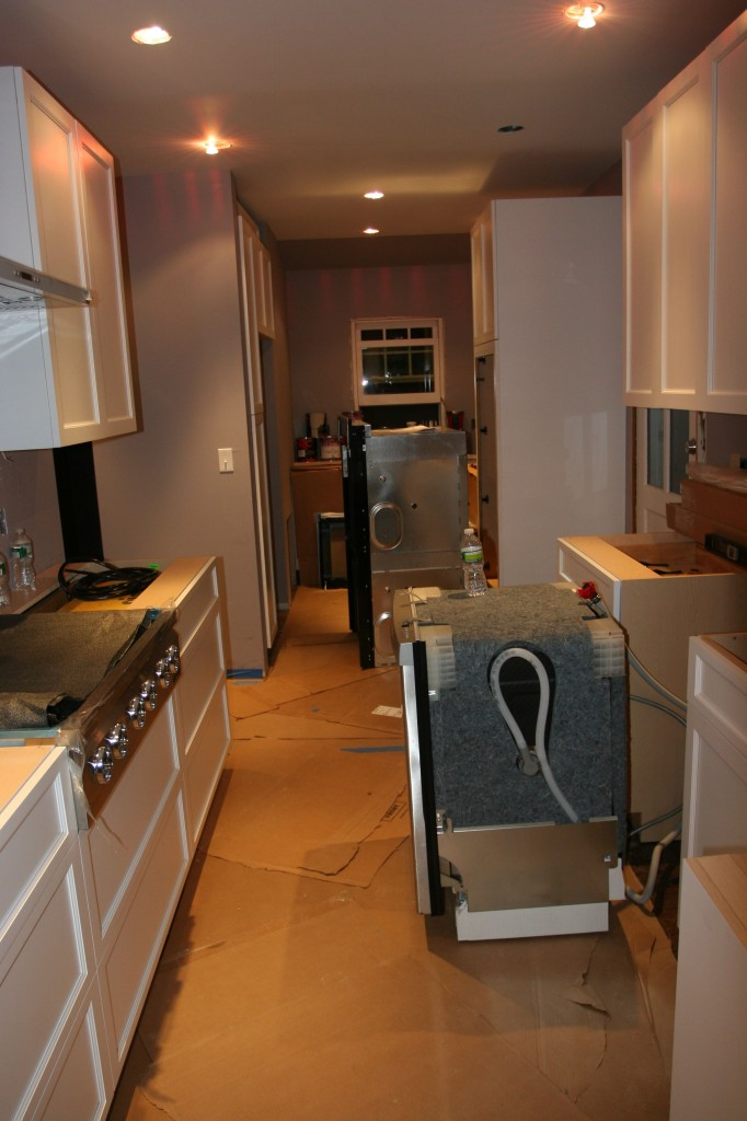 The appliances ready for their close-up (with Brad). By tomorrow, these should be snugly tucked away in their beds.