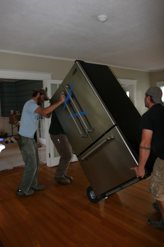 The first time they got the fridge on the dolly, it flattened the tires. Heavy.