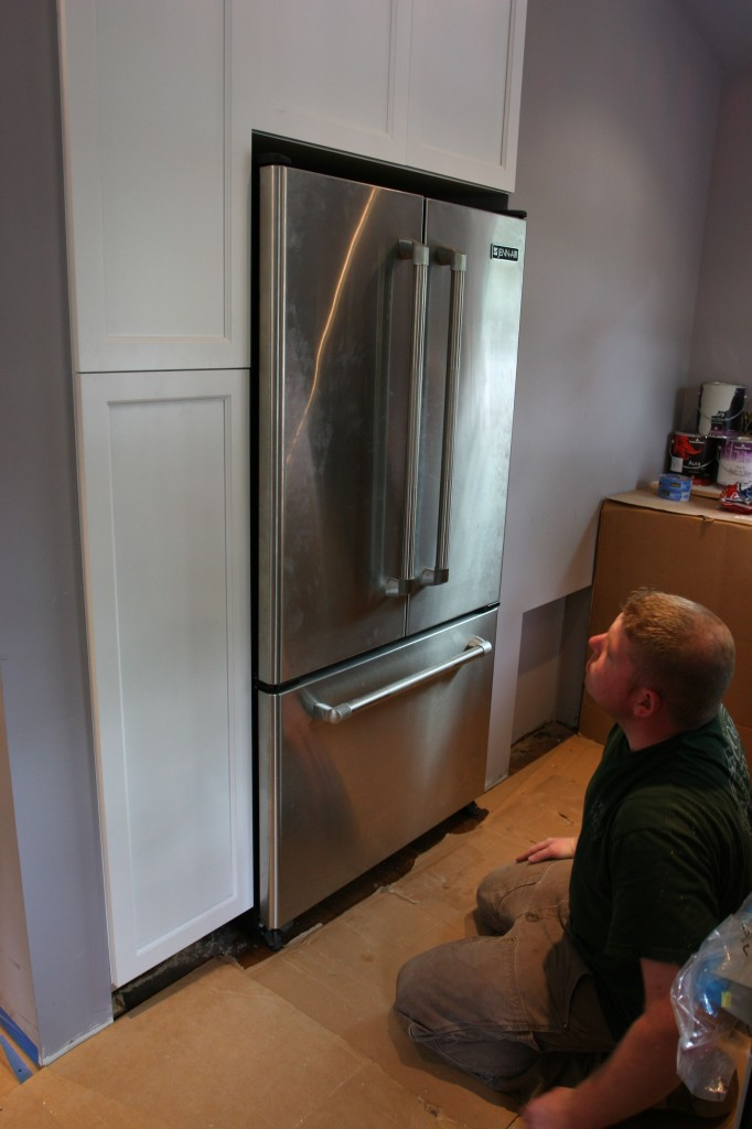 Brad at the alter of the refrigerator god. (Looks sharp, though, no?)