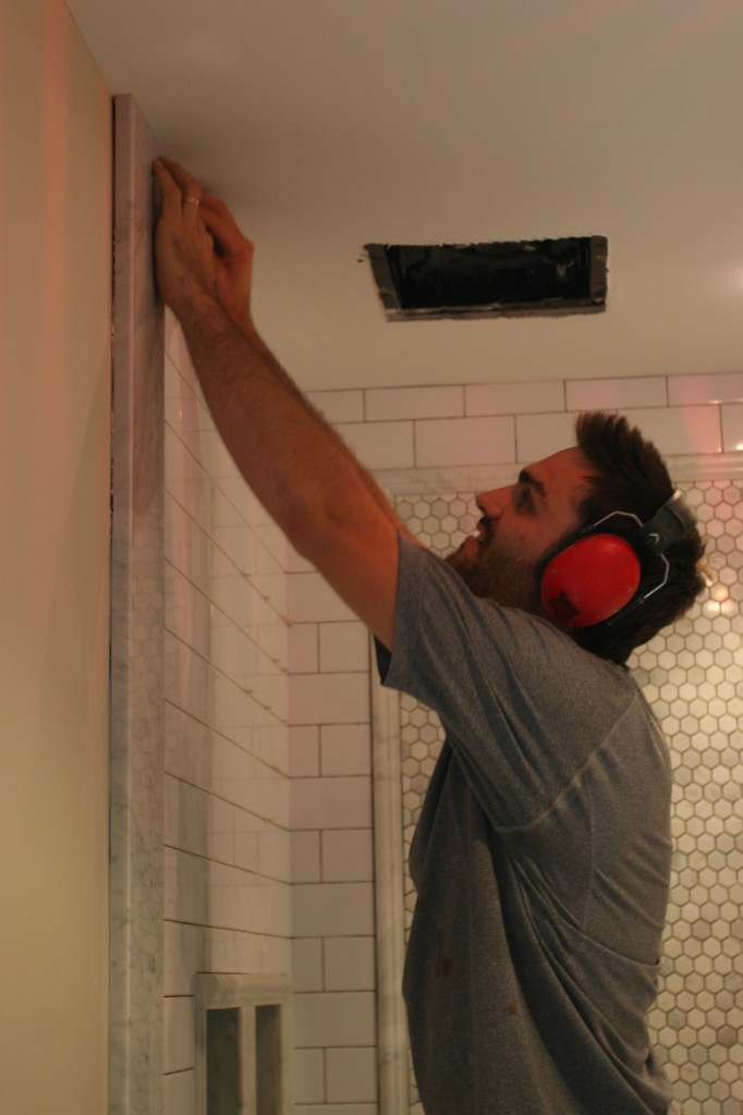 Caleb putting up the last tile. Only thing left was (at that point) the skirt, the curb and the grout.