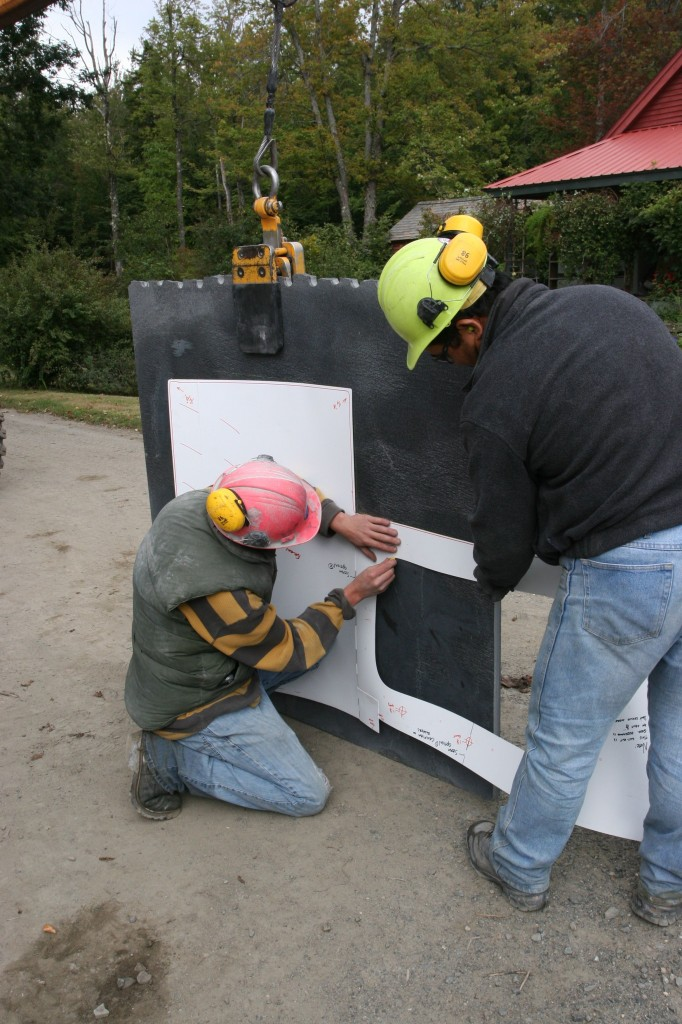 Brandon and Noah (?) marking out the template on the slab for our approval.
