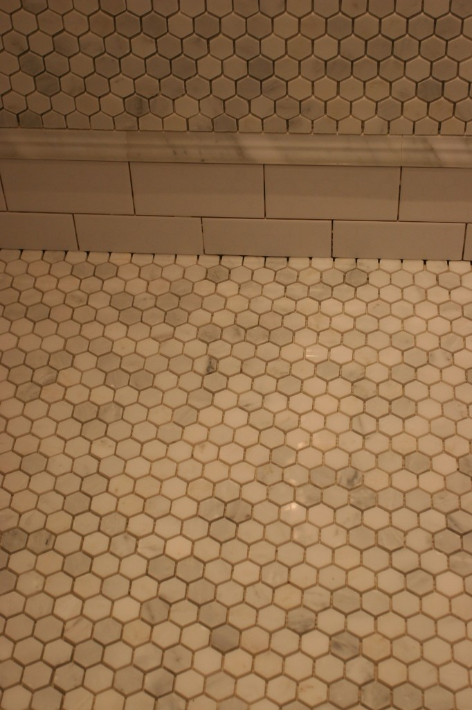 The wall, the skirt, the shower floor. These will look different after the grout goes on tomorrow.