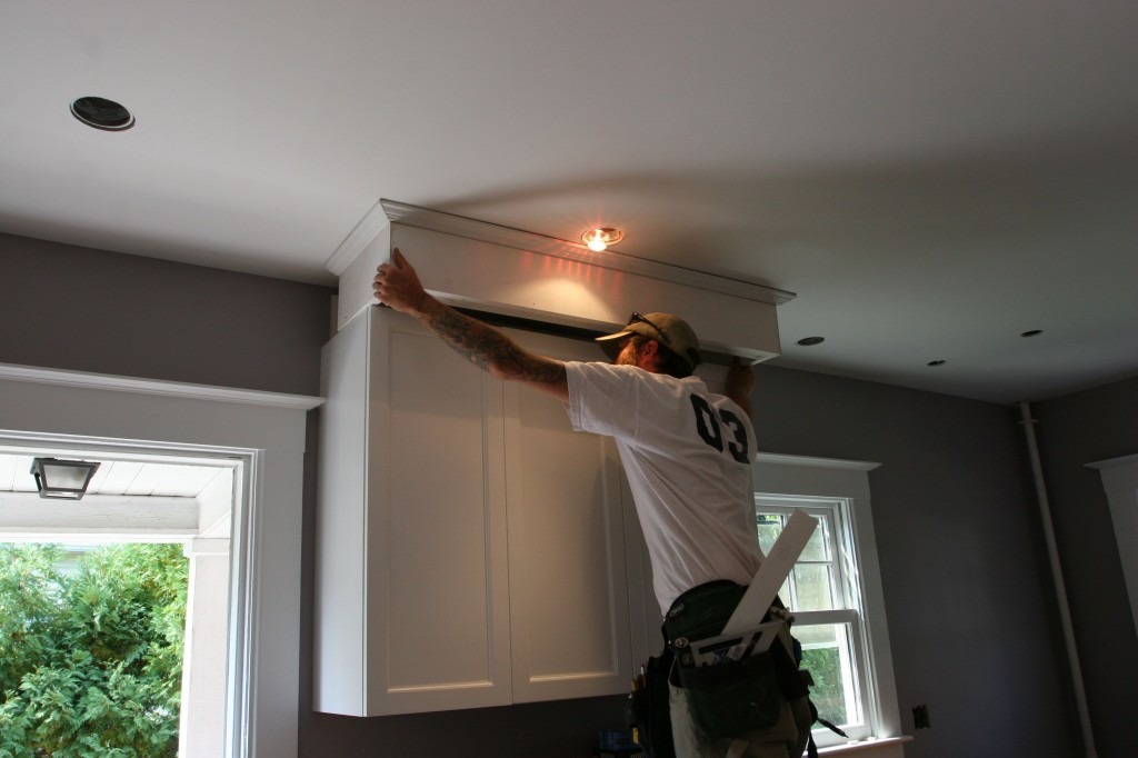 Negotiating past the blazing hot halogen bulb dangling from the ceiling.